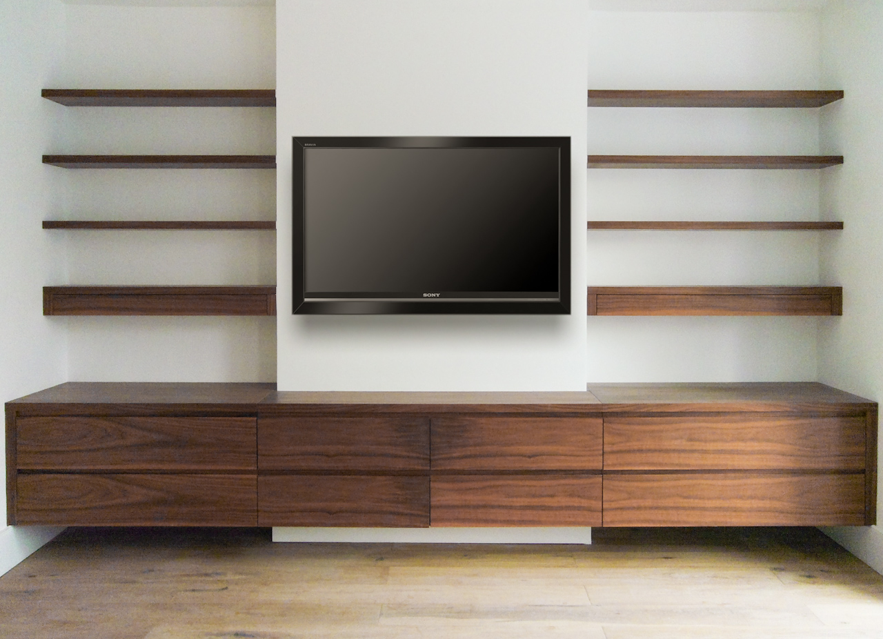 ... with the first shelf incorporating a drawer for remote controls etc.  The lower units are suspended off the floor. Shown here in the ever popular  walnut.